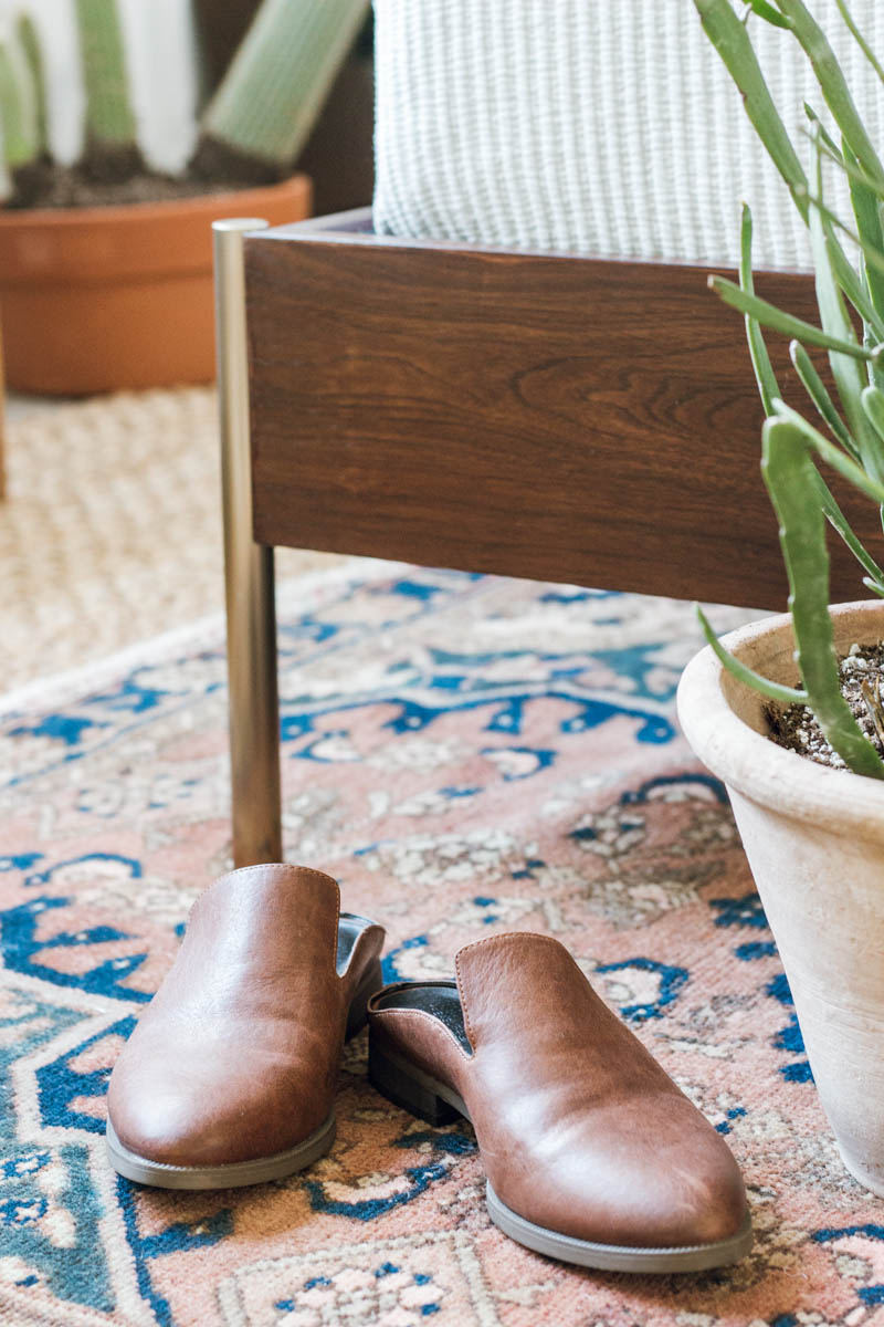 west elm bed mules shoes layered rugs euphorbia plant