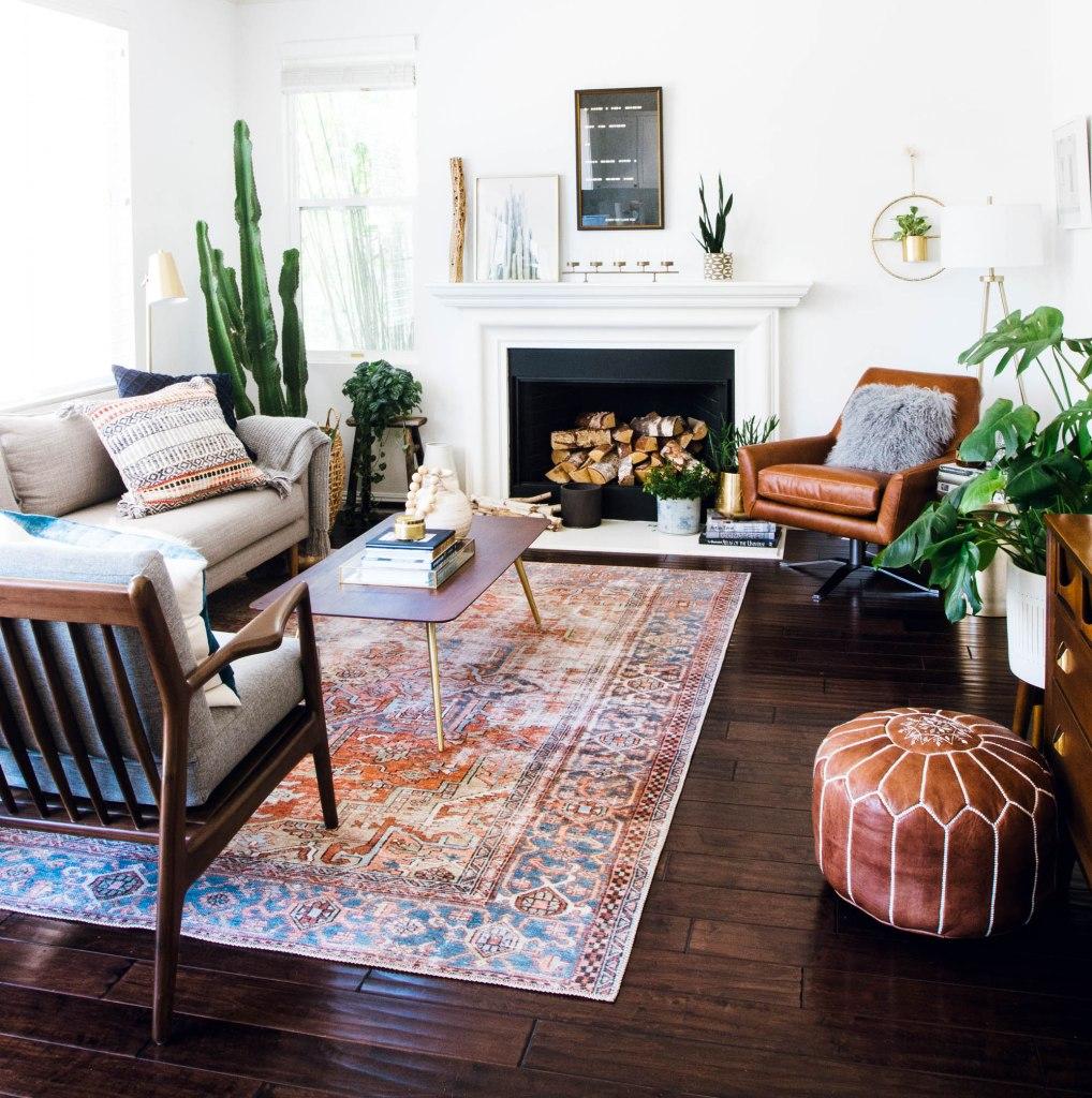 west elm leather chair, joy bird chair, loloi rug mid century family room fireplace mantel