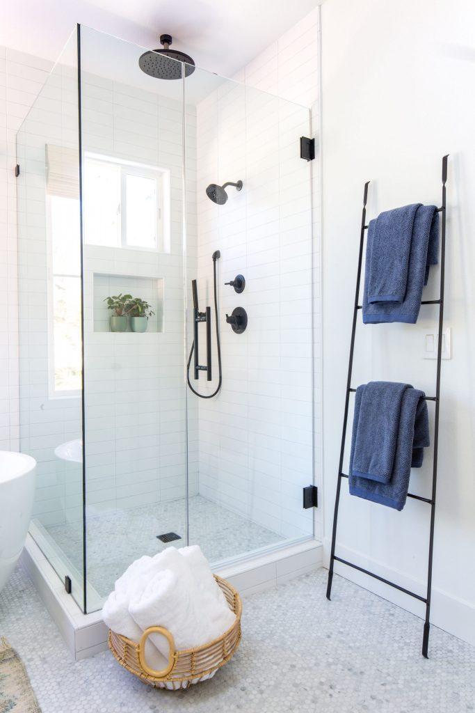 white shower tile delta shower  trim