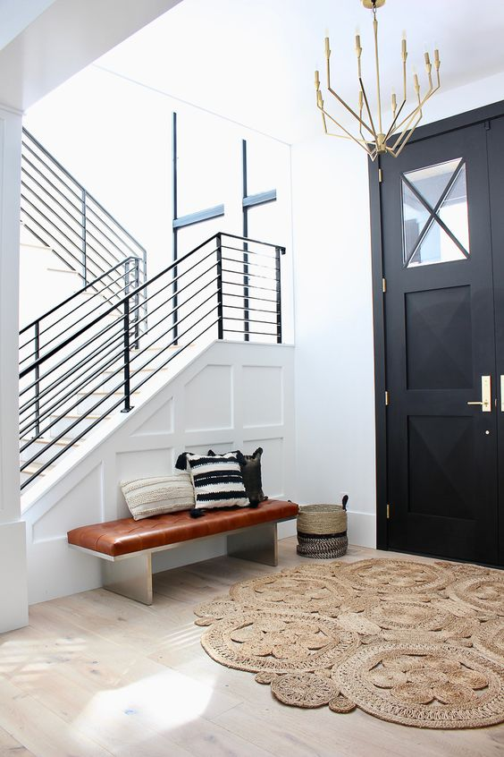 Entry with black railing