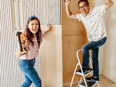 Travis on a stepladder and Anita holding power tools as the two take on an epic DIY!