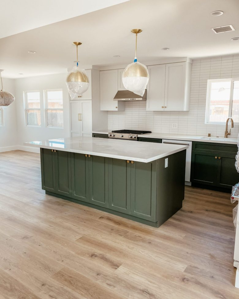 The full two-toned kitchen, complete with modern brass light fixtures