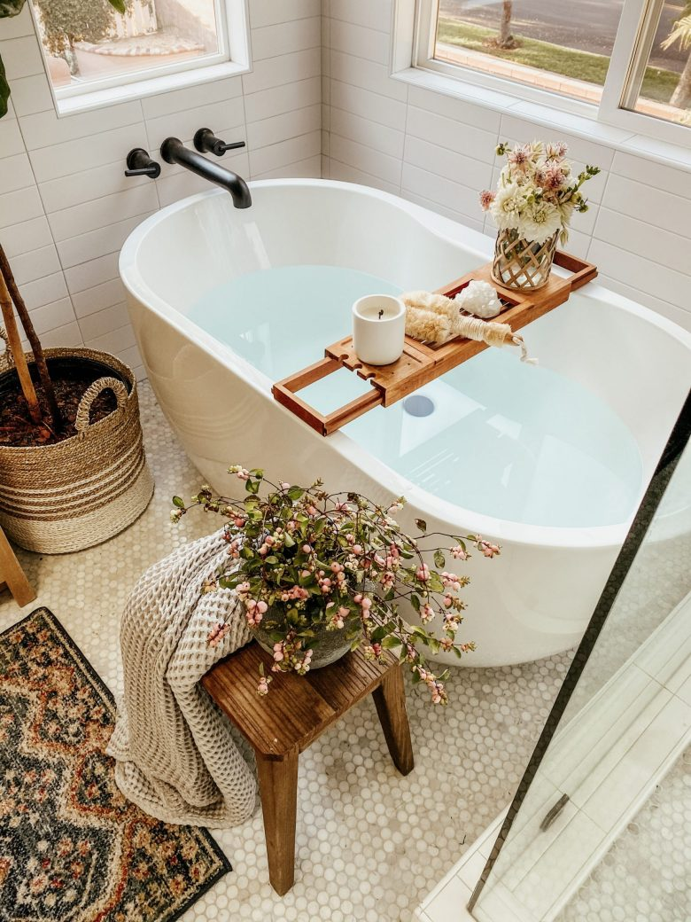 A relaxing bath drawn, complete with floral bouquet
