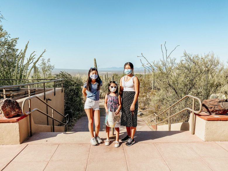 Emily, Natalie, & Rachel stand at the Desert Museum entrance in Arizona