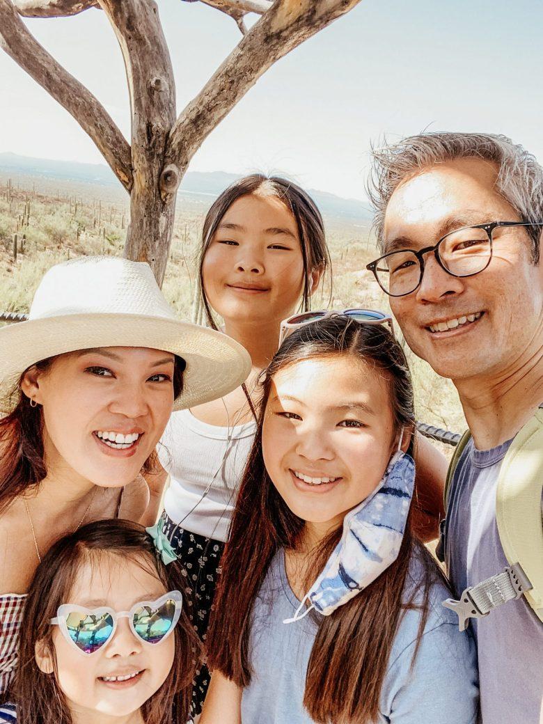 the whole Yokota family smiles in the desert shade!