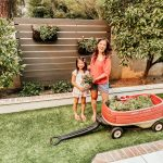 Anita & Natalie with the last of the Little Tikes toys: a red wagon