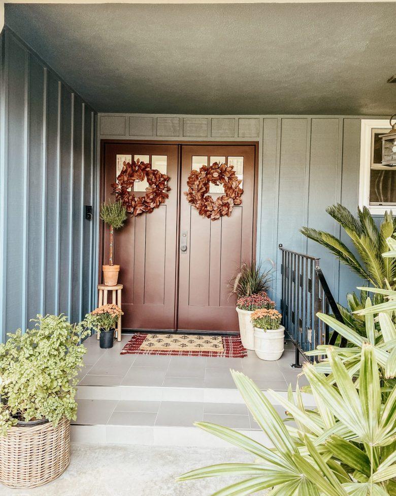 The front door has been transformed, too, with wreaths, doormat, and potted plants