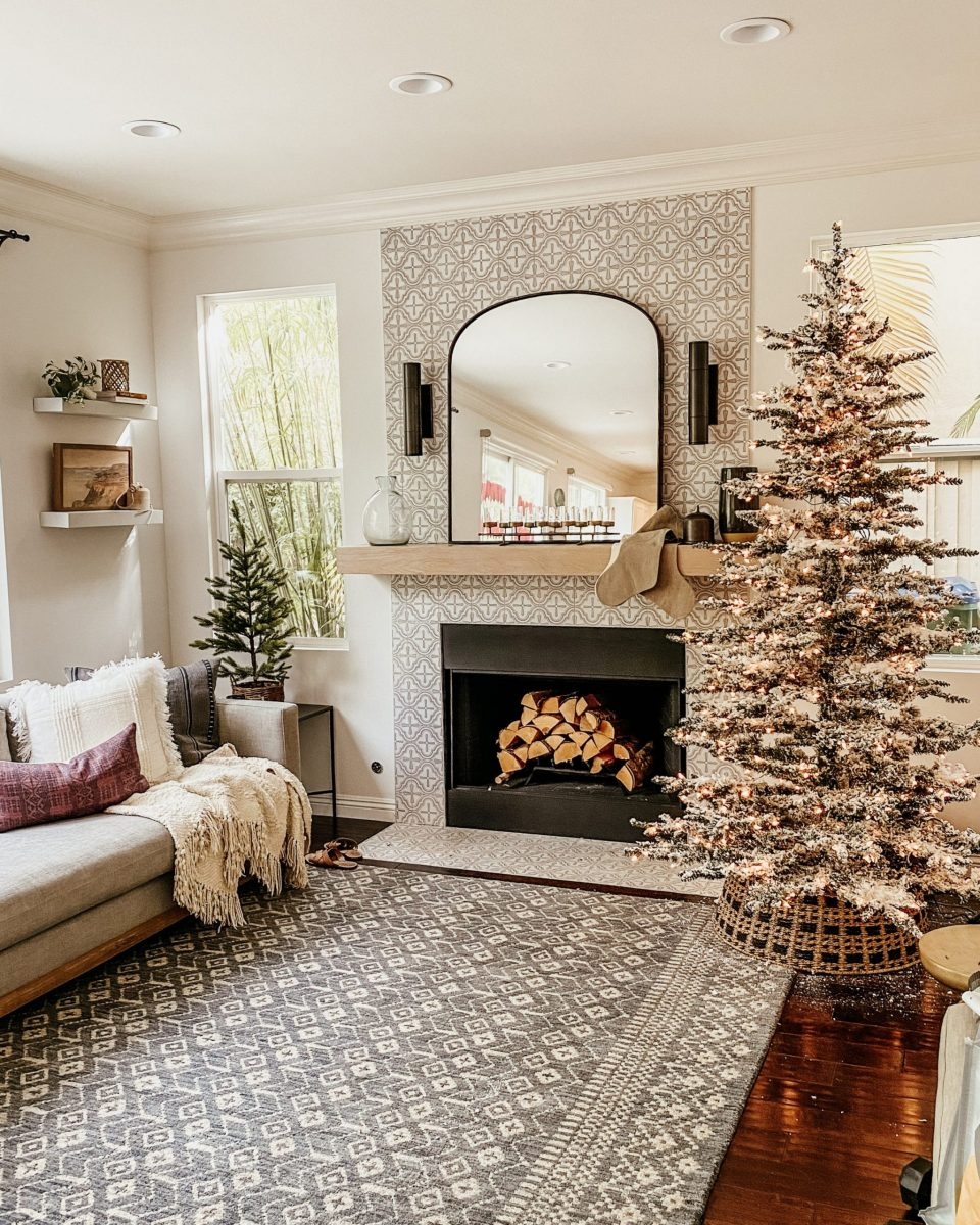 The tree is up in the family room, and cedar logs are in the fireplace