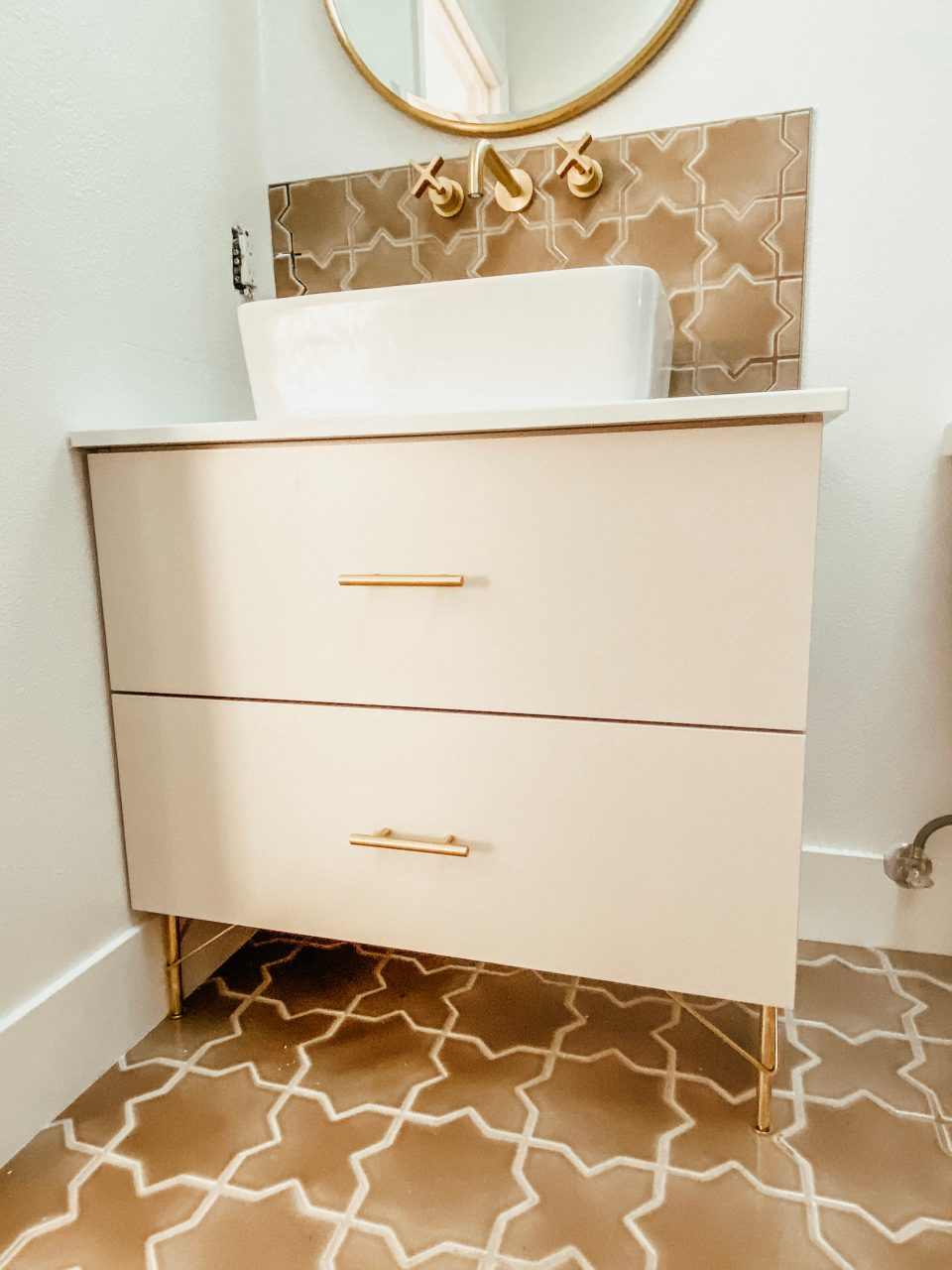 A close up of the in-progress vanity, with vessel sink settled on top, but not yet installed