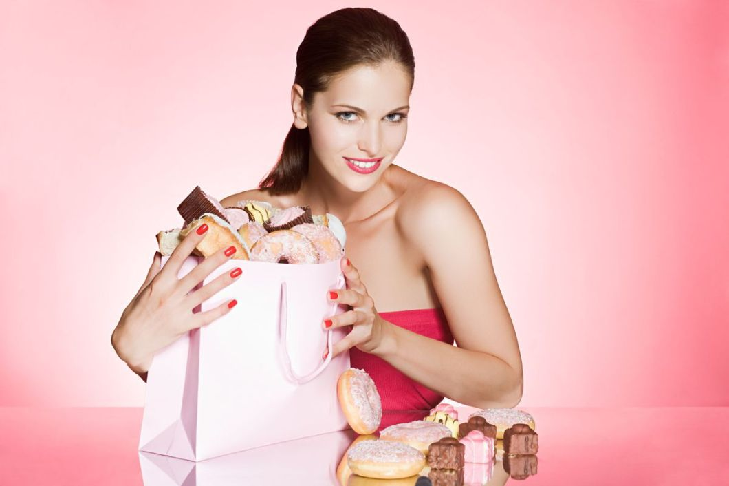 MINIMUM USAGE FEE £35. Please call Rex Features on 020 7278 7294 with any queries. Mandatory Credit: Photo by Image Source/REX/Shutterstock (1023934a) MODEL RELEASED, Young Woman With Bag Of Cakes And Donuts VARIOUS