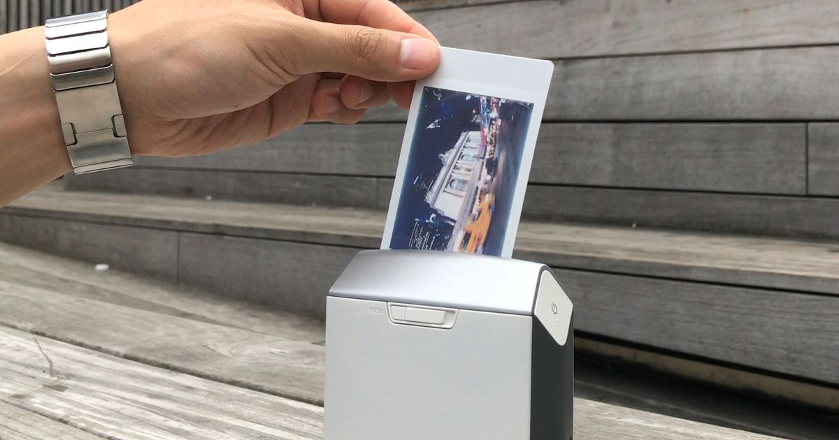 turn your iphone photos into polaroids instantly with this printer