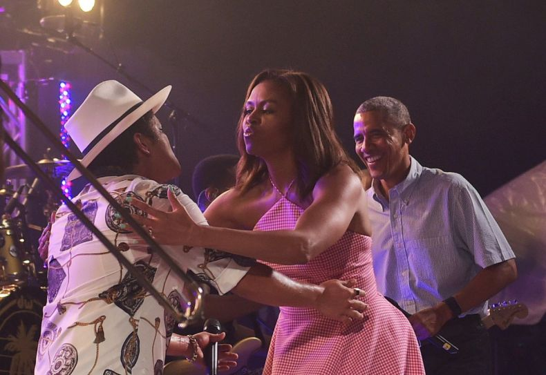 Michelle Obama greets performer Bruno Mars at an Independence Day celebration for military members and their families.