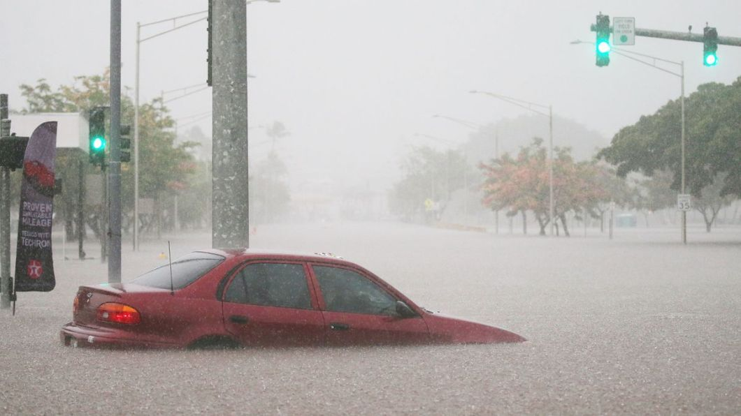 This car became submerged in floodwaters from Hurricane Lane rainfall on Aug. 23, in Hilo, Hawaii.