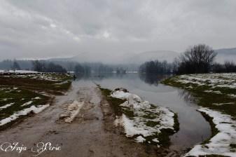 Flooded road at Radensko polje