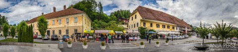 Panorama of farmers market from the square in the village centre