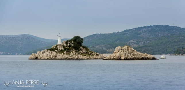 Islet with small lighthouse