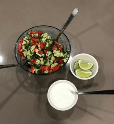 Served on the side is the cucumber and tomato salad, some fresh limes, and plain yogurt (though I usually spice it up!)
