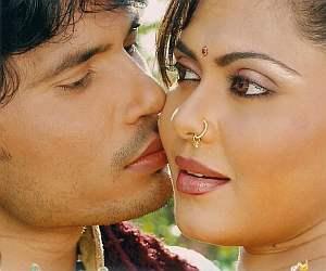 Pravesh planting a  kiss on Rinku Ghosh