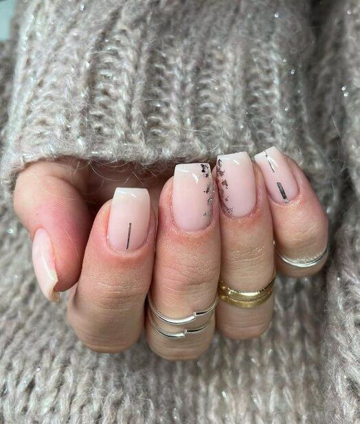 11. Nude Nails with Sparkly Tips
