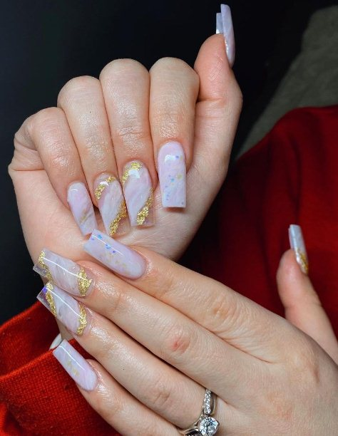 14. Pink Marble and Glitter Nails