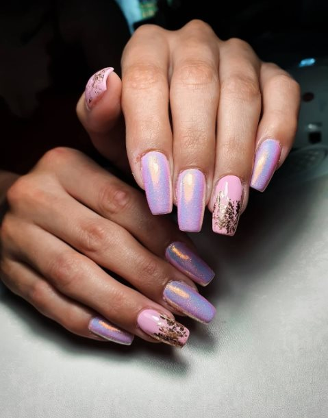 Pink manicure with blue glitter