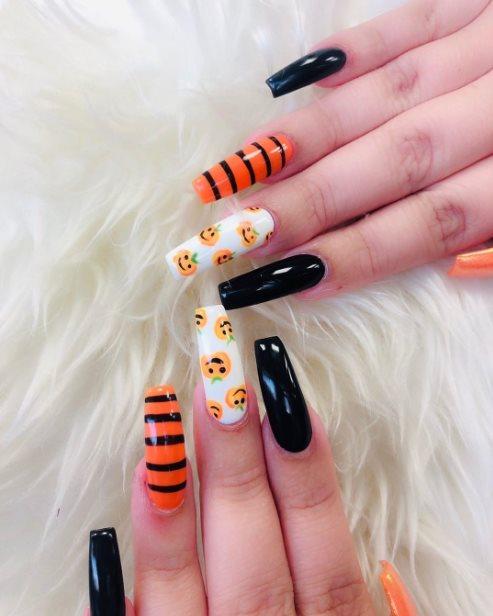 Orange and black manicure