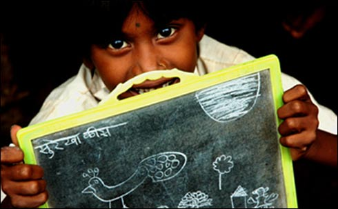 Indian Child With a Slate
