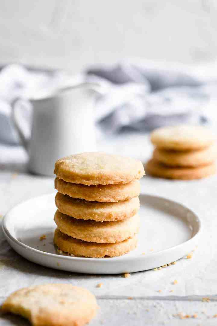 side view of a stack of cookies on a white plate