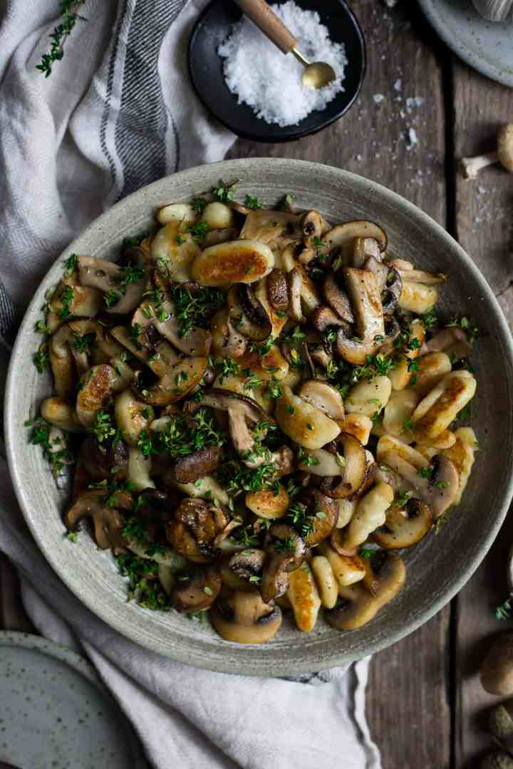 Vegan mushroom gnocchi cooked with fresh thyme and dry white wine | via @annabanana.co