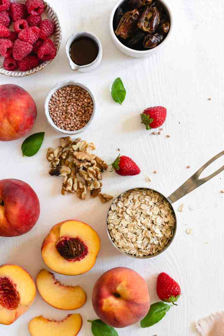 Ingredients for vegan peach tart topped with fresh summer fruit