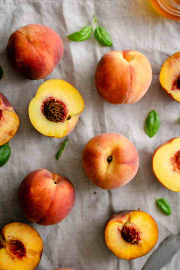 Fresh peaches on linen tablecloth