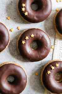 overhead shot of baked doughnuts with chocolate glaze