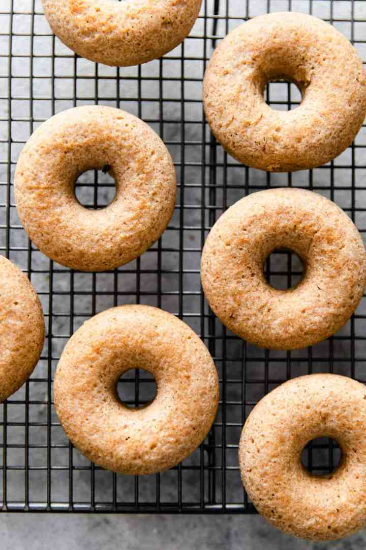 overhead shot of baked doughnuts on a cooling rack