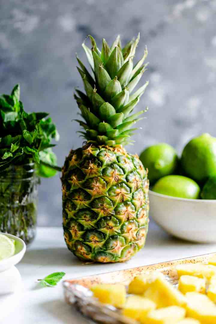 large fresh pineapple and some fresh mint