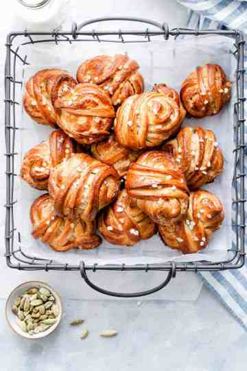 top view of cardamom buns in a wired basket