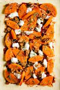 close up of butternut squash tart with goats' cheese and rosemary