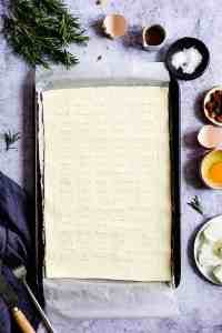 top view of puff pastry sheet on a baking tray