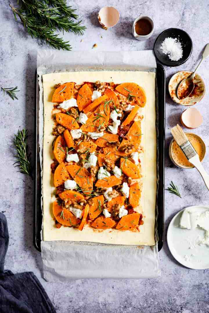 overhead shot of unbaked butternut squash and goats' cheese tart
