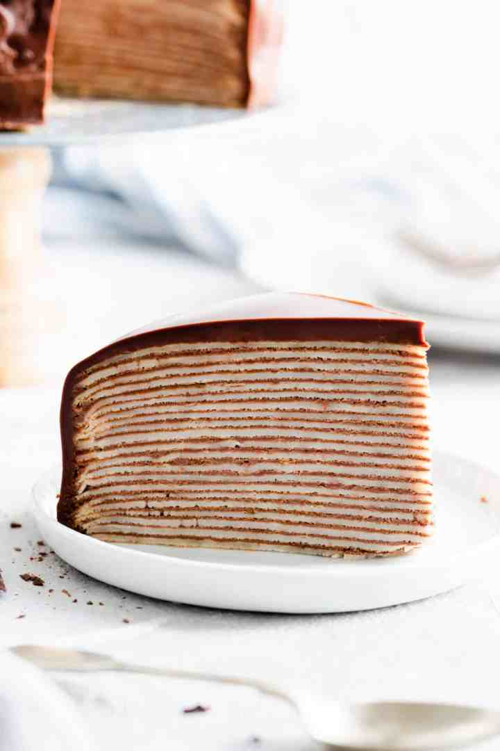 close up of a slice of cake showing the layers of crepes and chocolate