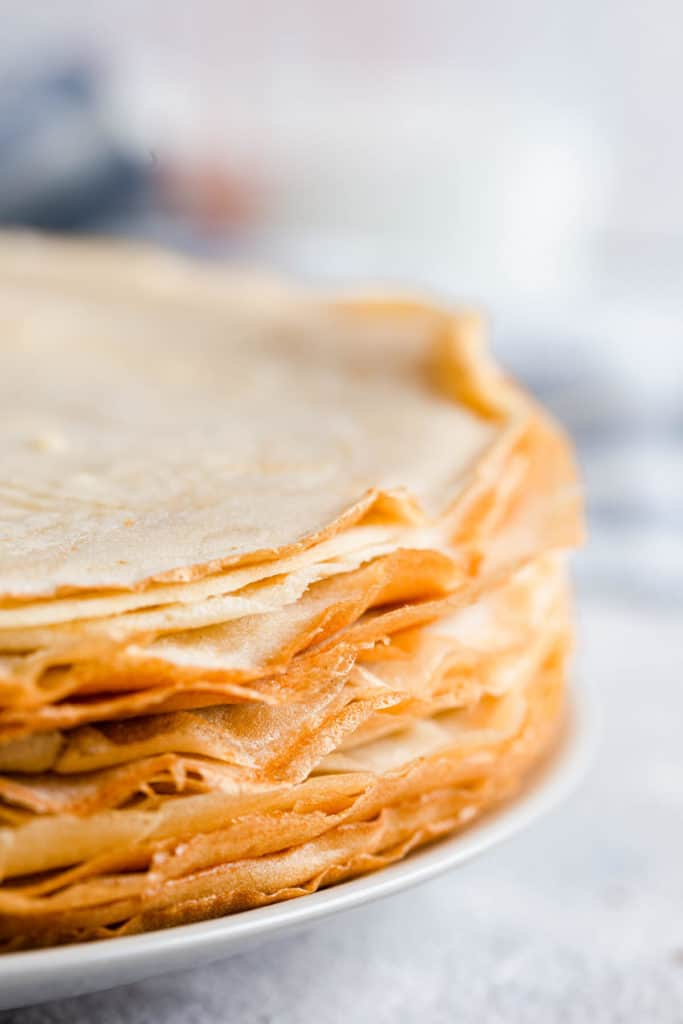 side close up of a stack of crepes