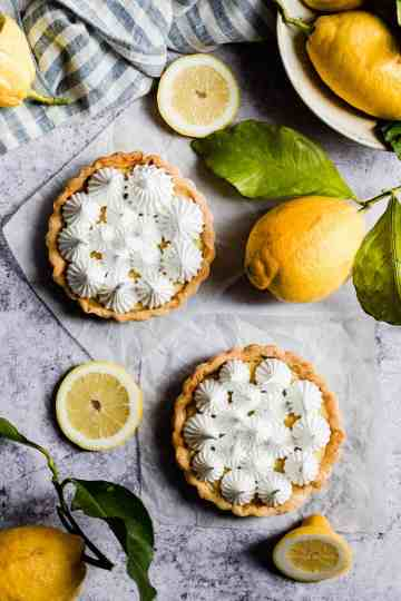 overhead shot of two small lemon pies topped with meringue