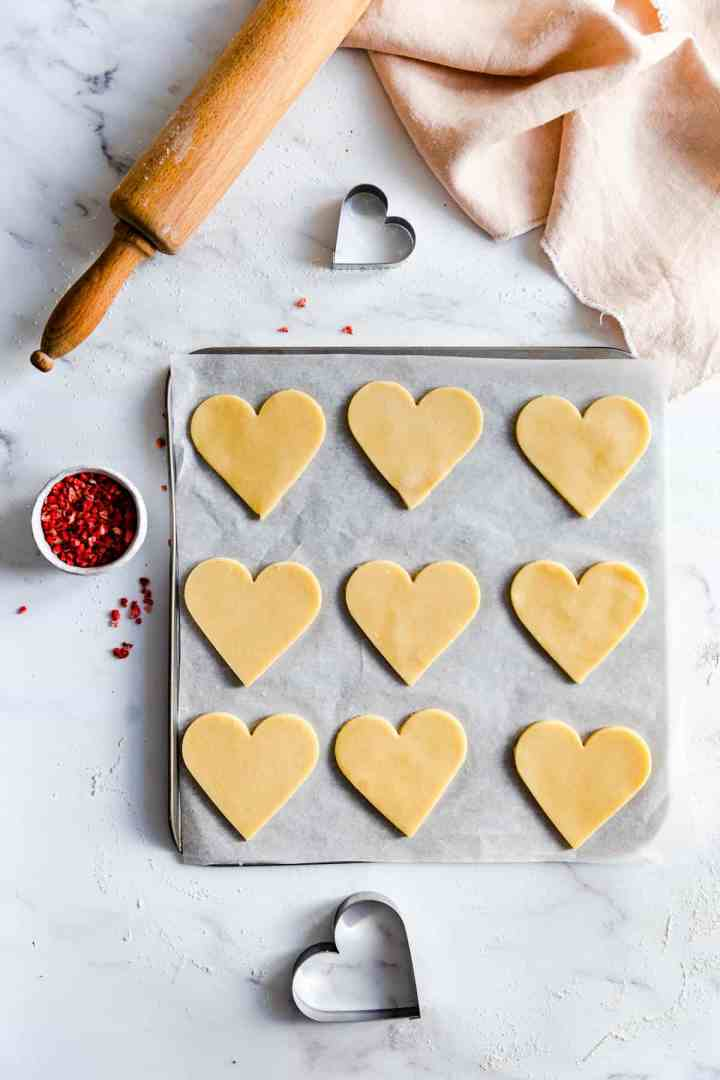 top view of heart sugar cookies on a baking tray