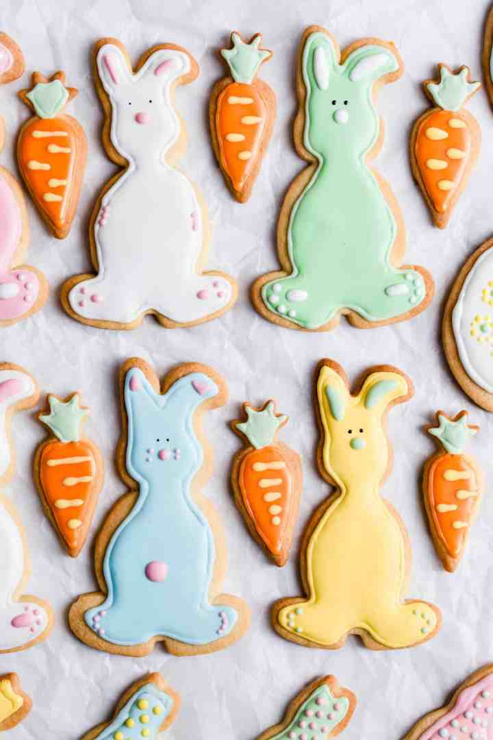 top view of bunny-shaped sugar cookies with icing