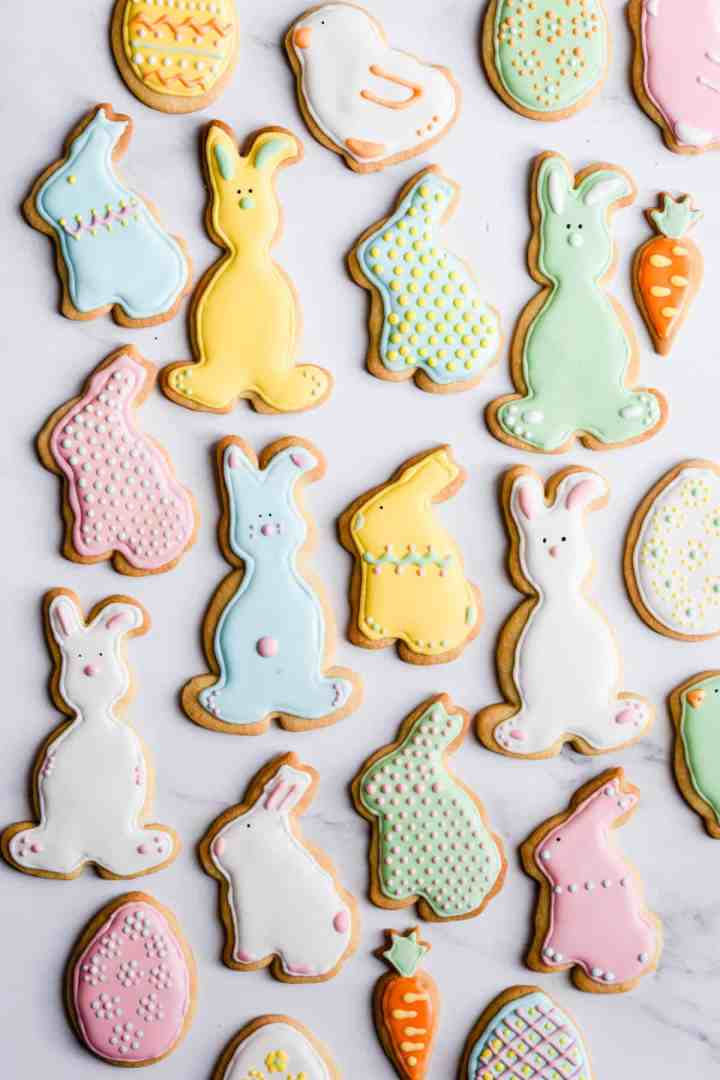 top view of colourful sugar cookies in different shapes and sizes