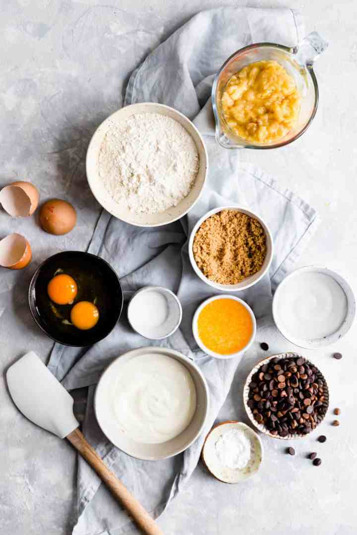 overhead view of bowls with different ingredients for banana bread