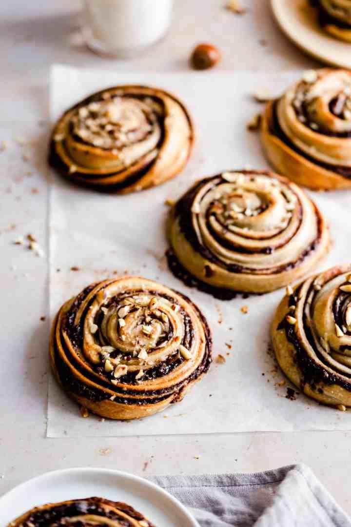 side view of hazelnut buns on baking paper