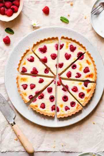 overhead shot of 8 slices of mascarpone tart with berries
