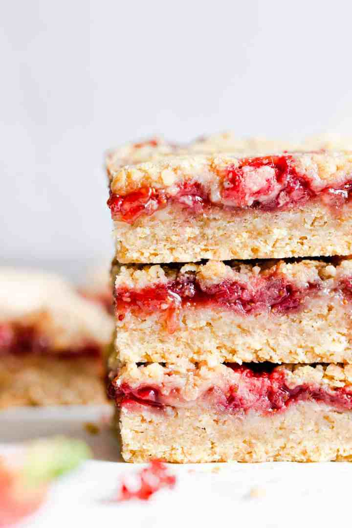side angle super close up at 3 strawberry crumble slices