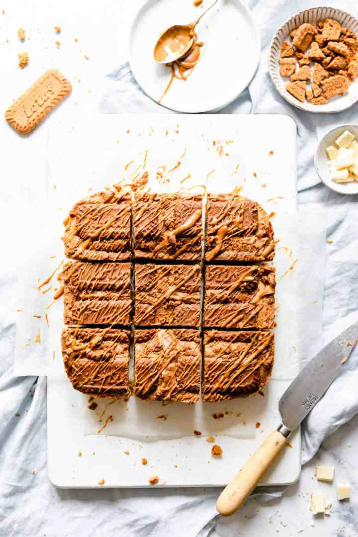 overhead shot of biscoff blondies cut into 9 square slices