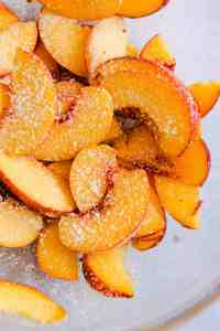 close up of sliced peaches dusted with cornflour